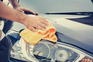 car detailing with yellow cloth