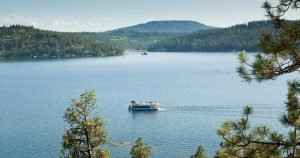 A tour boat cruises around Lake Coeur d'Alene