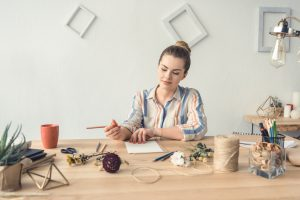 woman at desk working on DIY room decor