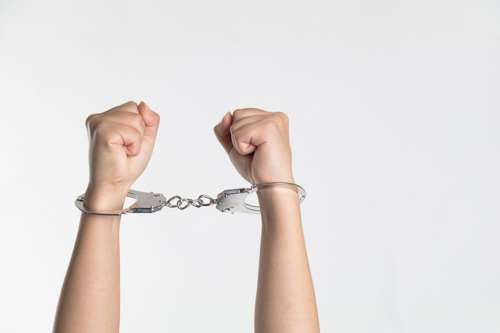 handcuffs around wrists - Springfield DUI