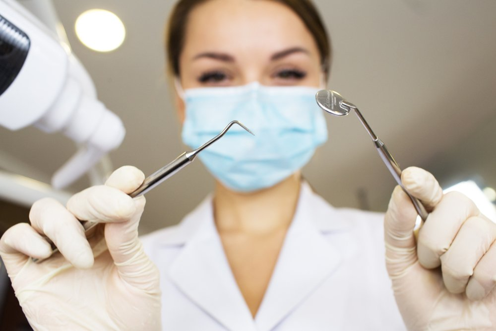 Female dentist with tools