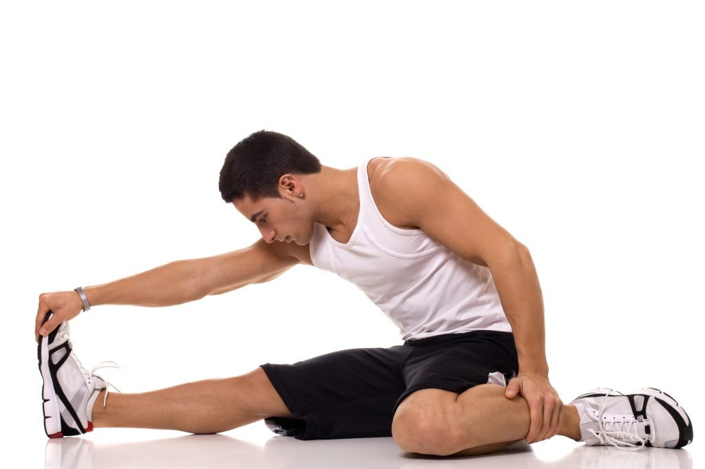 Man doing hamstring stretch