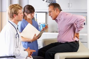 Male Patient Visiting Doctor's Office With Back Ache - CBD for Post-Surgery Pain Management