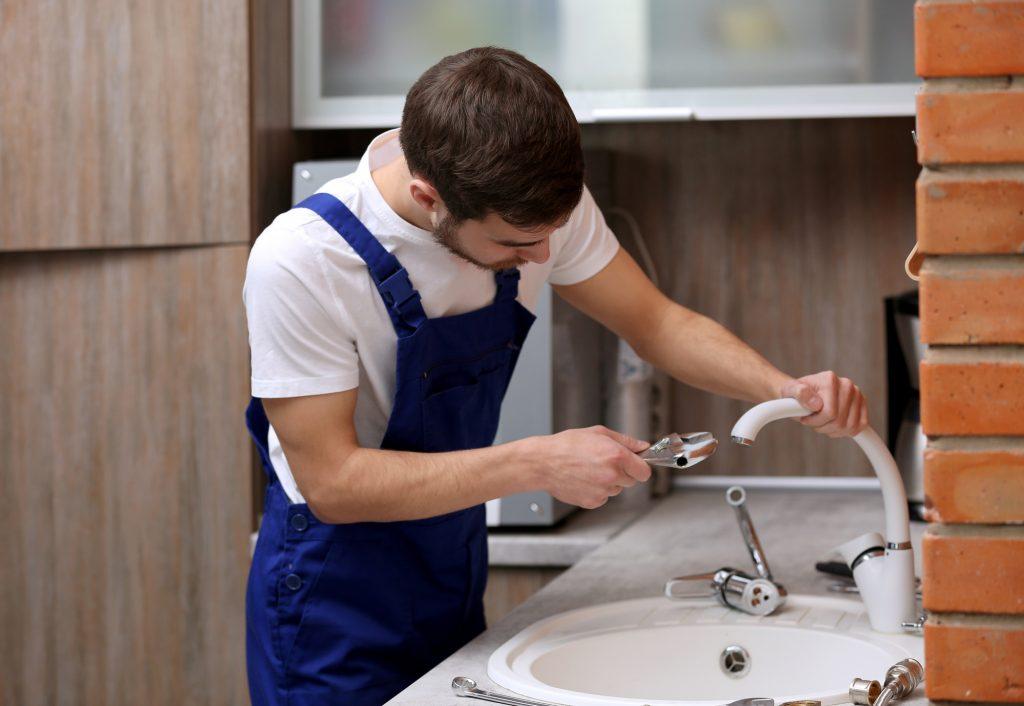 San Antonio plumbers fixing a sink