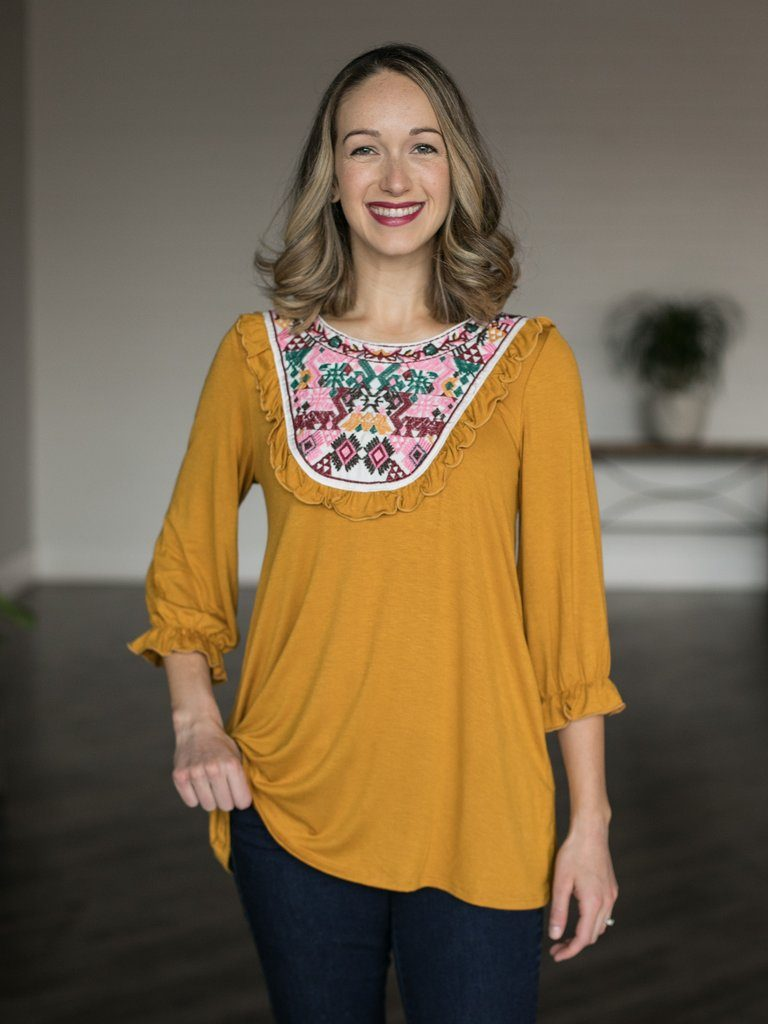model in mustard yellow boho embroidered top - modest summer clothes