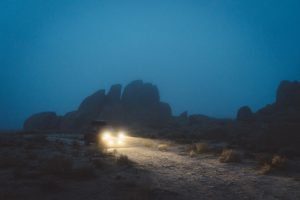 Vehcile driving in fog with high beams on - Best Off-Road Lighting For Jeep